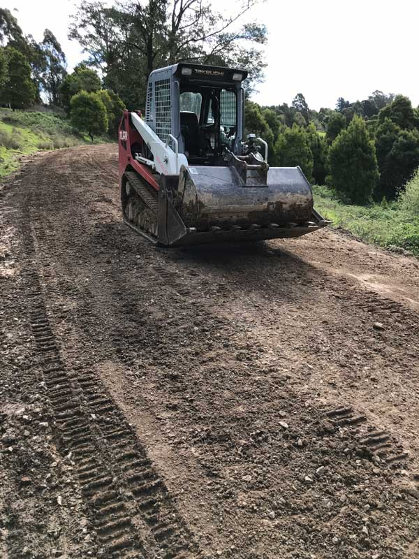 Latrobe Excavations Worksite with low loader truck carrying an excavator Latrobe Valley
