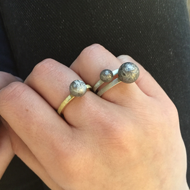 Meteorite rings in silver and gold by Robyn Wernicke.