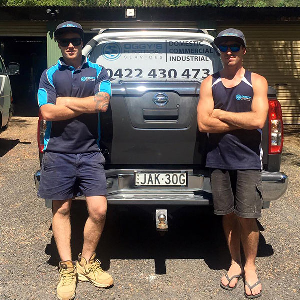 oggys-electrical-services-team-standing-with-ute