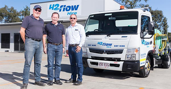 Three owners of H2flow Hire in front of a mini water truck