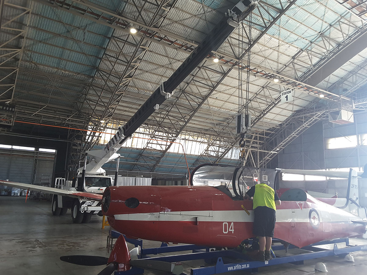 Project Cranes & Rigging franna crane in hangar Melbourne