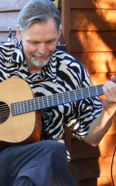 Sam Blight playing guitar