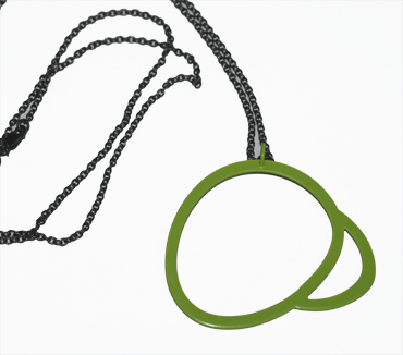 Sterling silver and green powder coated neckpiece by Sarah Wallace.