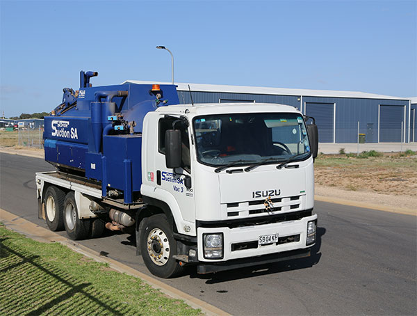 Super Suction SA blue hydro excavation water truck on trailer Adelaide
