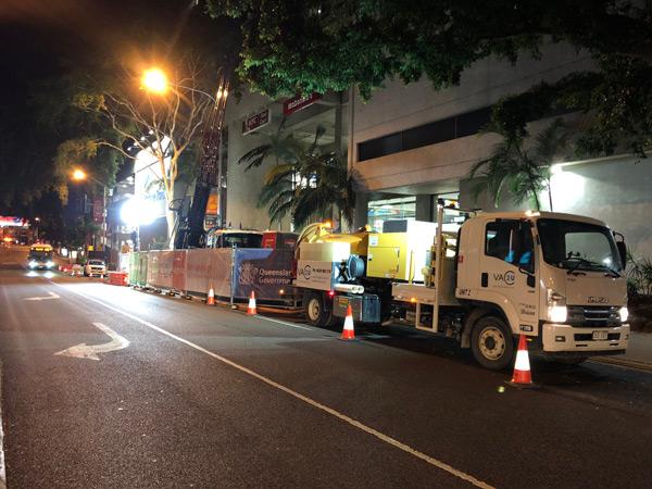 VAC2U vacuum excavation truck working at night